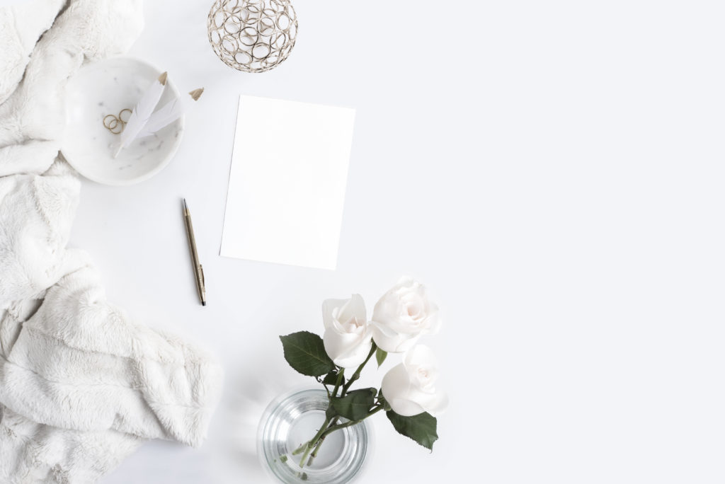 White fuzzy blanket with white roses and white stationary | Photographer: Her Creative Studio