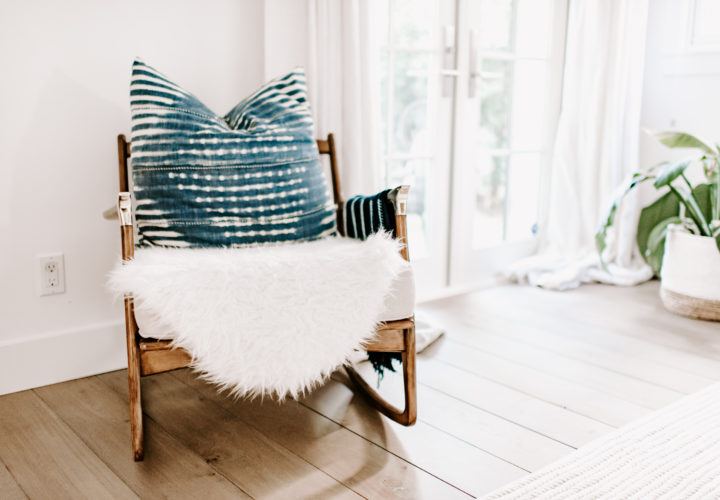 rocking chair with blue pillow in bedroom